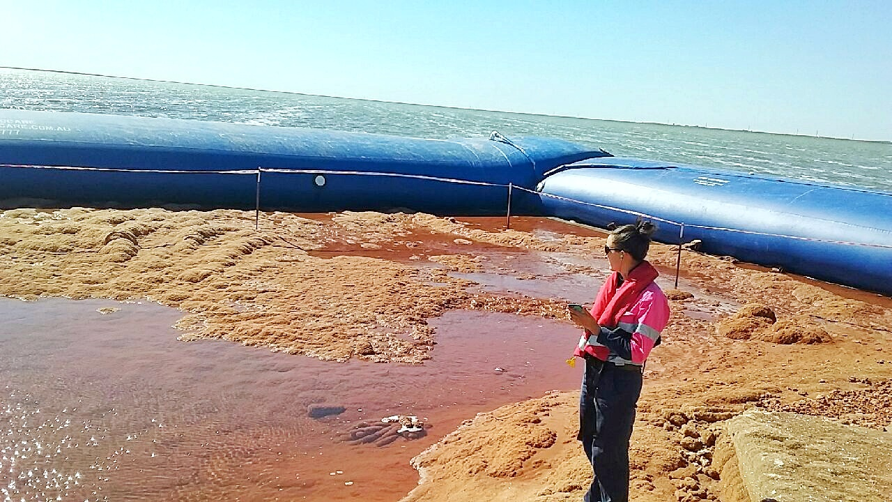 Installing aqua barriers on Dampier Salt Project 001small Apex Envirocare